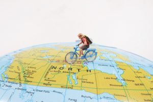 a mini figure Bicycle going around world